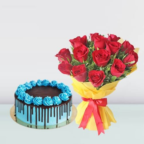 chocolate drip cake and red rose bouquet