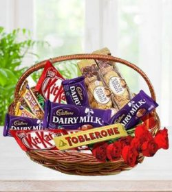 Chocolate with Red Roses Arrange in Basket